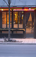 The trendy restaurant Riche with its wine bar. A bicycle parked by a tree but fallen. Stockholm, Sweden, Sverige, Europe