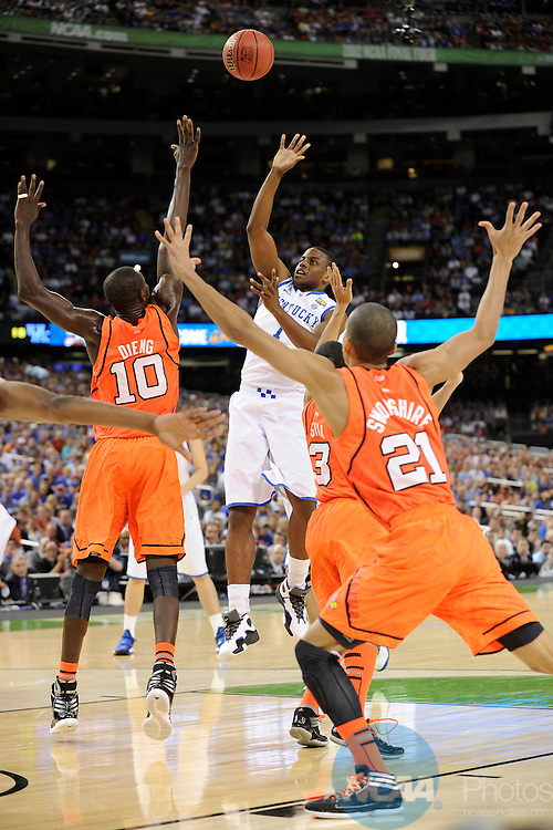 31 MAR 2012: Guard Darius Miller (1) from the University of Kentucky attempts a shot in front of center Gorgui Dieng (10) from the University of Louisville during the Semifinal Game of the 2012 NCAA Men's Division I Basketball Championship Final Four held at the Mercedes-Benz Superdome hosted by Tulane University in New Orleans, LA. Ryan McKeee/ NCAA Photos.