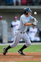 Rob Hudson #3 of the Birmingham Barons pops up a bunt attempt at Five County Stadium August 15, 2009 in Zebulon, North Carolina. (Photo by Brian Westerholt / Four Seam Images)