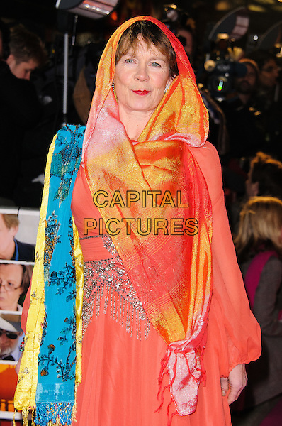 Celia Imrie.Arrivals at the'The Best Exotic Marigold Hotel' world premiere held at the Curzon Mayfair, London, England..February 7th, 2012.half length orange sari dress blue yellow red shawl wrap pashmina .CAP/CJ.©Chris Joseph/Capital Pictures.