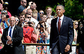 United States President Barack Obama arrives at the Tomb of the Unknown Soldier at Arlington National Cemetery, May 25, 2015 in Arlington, Virginia. <br /> Credit: Olivier Douliery / Pool via CNP