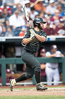 Vanderbilt Commodores designated hitter Ty Duval (20) follows through on his swing during Game 8 of the NCAA College World Series against the Mississippi State Bulldogs on June 19, 2019 at TD Ameritrade Park in Omaha, Nebraska. Vanderbilt defeated Mississippi State 6-3. (Andrew Woolley/Four Seam Images)