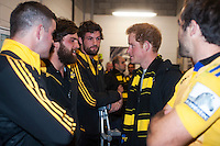 Prince Harry chats with Heiden Bedwell-Curtis in the changing rooms after the Super Rugby match between the Hurricanes and Sharks at Westpac Stadium, Wellington, New Zealand on Saturday, 9 May 2015. Photo: Dave Lintott / lintottphoto.co.nz