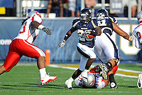 9 October 2010:  FIU running back Darrian Mallary (26) carries the ball in the third quarter as the FIU Golden Panthers defeated the Western Kentucky Hilltoppers, 28-21, at FIU Stadium in Miami, Florida.