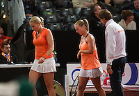 Februari 08, 2015, Apeldoorn, Omnisport, Fed Cup, Netherlands-Slovakia, doubles, l.t.r.: Michaella Krajicek and Richel Hogenkamp and captain Paul Haarhuis<br /> Photo: Tennisimages/Henk Koster