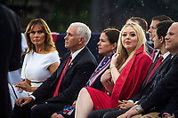 """U.S. First Lady Melania Trump looks at Tiffany Trump as U.S. Vice President Mike Pence and Second Lady Karen Pence listen as U.S. President Donald Trump, not pictured, speaks during the Fourth of July Celebration 'Salute to America' event in Washington, D.C., U.S., on Thursday, July 4, 2019. The White House said Trump's message won't be political -- Trump is calling the speech a """"Salute to America"""" -- but it comes as the 2020 campaign is heating up. <br /> h<br /> CAP/MPI/CNP<br /> ©CNP/MPI/Capital Pictures"""