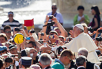 Papa Francesco tiene la sua centesima udienza generale del mercoledi' in Piazza San Pietro, Citta' del Vaticano, 26 agosto 2015.<br /> Pope Francis tries to grab a ball thrown by the faithful as he arrives for his hundredth weekly general audience in St. Peter's Square at the Vatican, 26 August 2015.<br /> UPDATE IMAGES PRESS/Riccardo De Luca<br /> <br /> STRICTLY ONLY FOR EDITORIAL USE