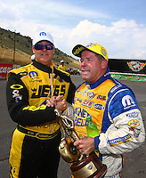 Jul. 20, 2014; Morrison, CO, USA; Jeg Coughlin Jr (left) congratulates NHRA pro stock driver Allen Johnson after winning the Mile High Nationals at Bandimere Speedway. Mandatory Credit: Mark J. Rebilas-