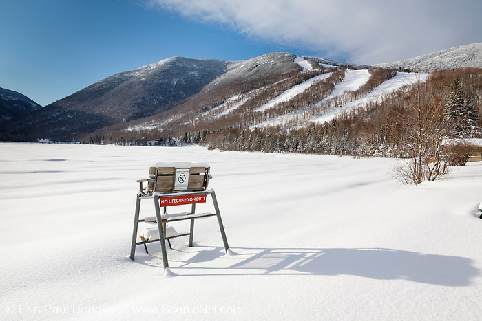 Franconia Notch State Park - Cannon Mountain from Echo Lake beach in the White Mountains, New Hampshire USA during the winter months
