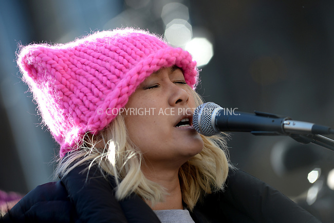 www.acepixs.com<br /> January 20, 2018  New York City<br /> <br /> MILCK performs for crowds of protesters at the Women's March on January 20, 2018 in New York City.<br /> <br /> Credit: Kristin Callahan/ACE Pictures<br /> <br /> Tel: 646 769 0430<br /> Email: info@acepixs.com