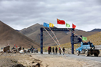 "Where the road to Everest base camp begins near New Tingri.<br /> China started building a controversial 67-mile ""paved highway fenced with undulating guardrails"" to Mount Qomolangma, known in the west as Mount Everest, to help facilitate next year's Olympic Games torch relay.<br /> Tibet, China<br /> July, 2007"