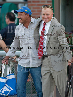Scott Blasi, right, assistant to Steve Asmussen, celebrates with barn employee Juan Gonzalez (I think the hotwalker for My Miss Aurelia) after My Miss Aurelia's victory in the Frizette Stakes, 10-8-11, Belmont Park.