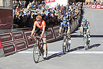 Riders cross the finish line at the end of a very dusty Strade Bianche 2019 running 184km from Siena to Siena, held over the white gravel roads of Tuscany, Italy. 9th March 2019.<br /> Picture: Eoin Clarke | Cyclefile<br /> <br /> <br /> All photos usage must carry mandatory copyright credit (© Cyclefile | Eoin Clarke)