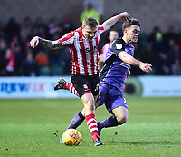 Lincoln City's Harry Anderson is fouled by Port Vale's Luke Hannant<br /> <br /> Photographer Andrew Vaughan/CameraSport<br /> <br /> The EFL Sky Bet League Two - Lincoln City v Port Vale - Tuesday 1st January 2019 - Sincil Bank - Lincoln<br /> <br /> World Copyright © 2019 CameraSport. All rights reserved. 43 Linden Ave. Countesthorpe. Leicester. England. LE8 5PG - Tel: +44 (0) 116 277 4147 - admin@camerasport.com - www.camerasport.com