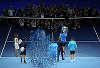 As Novak Djokovic (SRB) lifts the trophy, a plume of confetti launches up during Day Eight of the Barclays ATP World Tour Finals 2015 played at The O2, London on November 22nd 2015