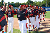 Batavia Muckdogs pitcher Javier Garcia (36) and teammates including Michael Mertz (26) and RJ Peace congratulate each other after a game against the Auburn Doubledays on September 5, 2016 at Dwyer Stadium in Batavia, New York.  Batavia defeated Auburn 4-3. (Mike Janes/Four Seam Images)
