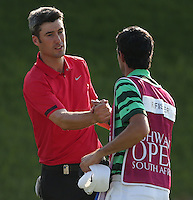 Ross Fisher (ENG) and caddie Chris Harmston shake hands after a successful card of 65 (no dropped shots) during Round Two of The Tshwane Open 2014 at the Els (Copperleaf) Golf Club, City of Tshwane, Pretoria, South Africa. Picture:  David Lloyd / www.golffile.ie
