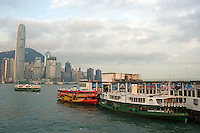 Ferries in the harbor with view of skyline, Kowloon, Hong Kong, China.
