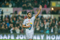 Sunday 9th November 2014<br /> Pictured: Neil Taylor of Swansea City applauds fans after the game <br /> Re: Barclays Premier League Swansea City v Arsenal at the Liberty Stadium, Swansea, Wales,UK
