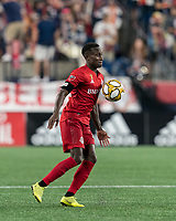 FOXBOROUGH, MA - AUGUST 31: Richie Laryea #22 of Toronto FC collects a pass during a game between Toronto FC and New England Revolution at Gillette Stadium on August 31, 2019 in Foxborough, Massachusetts.