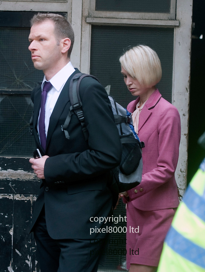 Gareth Williams - MI6 body in holdall  inquest ended today 2.5.12..Family members leave court. -..k.  sister  Ceri Subbe - who gave evidence  and her husband Chris Subbe - walk past waiting police after the verdict.....Pic by Gavin Rodgers/Pixel 8000 Ltd