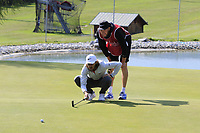 Tommy Fleetwood (ENG) lines up his putt on the 12th green during Thursday's Round 1 of the 2017 Omega European Masters held at Golf Club Crans-Sur-Sierre, Crans Montana, Switzerland. 7th September 2017.<br /> Picture: Eoin Clarke | Golffile<br /> <br /> <br /> All photos usage must carry mandatory copyright credit (&copy; Golffile | Eoin Clarke)