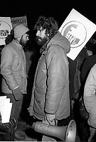 Montreal (Qc) CANADA -December 5 1984 file Photo<br /> -A  FAECVM (student association) demonstration organiser, identified at the time as Christian Yaccarini hold a megaphone and sign during a peacefull student march,<br /> <br /> Notes from official biography webpage :<br /> . Christian Yaccarini holds a bachelor`s degree in Political Science from the Université du Québec à Montréal. After graduating, Mr. Yaccarini worked in community action. With colleagues, he participated in the creation of the Community Economic Development Corporations for Centre-Nord and Rosemont - Petite-Patrie.<br /> <br /> In 1995, Mr. Yaccarini founded the Angus Development Corporation (SDA), a social economy company with a mission to acquire and develop the land previously occupied by the Angus locomotive shops. He is the President and Chief Executive Officer of SDA, which is now developing the urban business park called Technopôle Angus.<br /> <br /> Technopôle Angus is the only business park in Québec that was designed, developed and is managed using an environmentally-friendly approach. This sustainable development approach translates into a diverse range of tangible and fruitful actions, whether they touch the construction and management of the lands and buildings or measures and services put in place for the benefit of the park`s 40 companies, employing some 1,000 workers.<br /> <br /> From 2000 to 2003, Mr. Yaccarini was Chairman of the Board of Administrators of the Fonds d'action québécois de développement durable. As such, he initiated the creation of the Fonds d'investissement en développement durable (FIDD), an investment fund that comprises the Fonds d'action québécois en développement durable, Fondaction CSN and Solidarity Fund QFL.