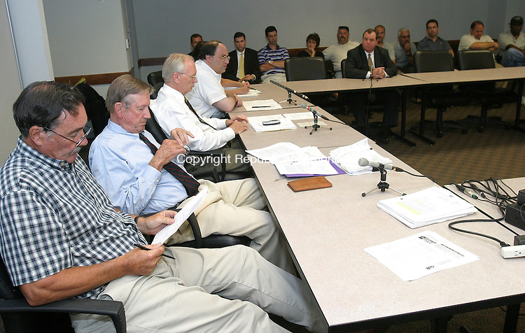 WATERBURY, CT 18 July 2005 -071805BZ03- Members of the oversight board, at left, and members of the Waterbury Police Union, across top of photo, during an oversight board meeting at the Rowland Government Center Monday afternoon.<br /> Jamison C. Bazinet Photo