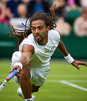 26-06-13, England, London,  AELTC, Wimbledon, Tennis, Wimbledon 2013, Day three, Dustin Brown (GER)<br /> <br /> <br /> <br /> Photo: Henk Koster