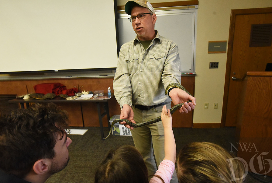 NWA Democrat-Gazette/FLIP PUTTHOFF <br /> SNAKES ALIVE<br /> Chris Pistole, interpreter at Hobbs State Park-Conservation Area, lets visitors on Saturday March 23 2019 see and touch a live speckled king snake during his program on reptiles at the park. Pistole also brought a box turtle and showed the shells from snapping turtles.