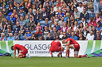 Wales players look dejected after conceding a last second try which cost them the game against Australia <br /> <br /> Australia Vs Wales - Men's quarter-final<br /> <br /> Photographer Chris Vaughan/CameraSport<br /> <br /> 20th Commonwealth Games - Day 4 - Sunday 27th July 2014 - Rugby Sevens - Ibrox Stadium - Glasgow - UK<br /> <br /> © CameraSport - 43 Linden Ave. Countesthorpe. Leicester. England. LE8 5PG - Tel: +44 (0) 116 277 4147 - admin@camerasport.com - www.camerasport.com
