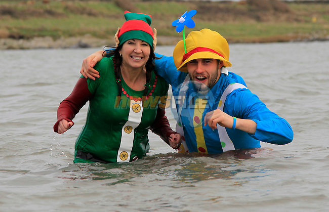 During the Polar Plunge in aid of the Special Olympics on Clogherhead beach on Saturday 6th December 2014.<br /> Picture:  Thos Caffrey / www.newsfile.ie