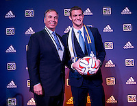 #23 overall pick Kyle Venter of the LA Galaxy stands with head coach Bruce Arena during the MLS SuperDraft at the Pennsylvania Convention Center in Philadelphia, PA, on January 16, 2014.