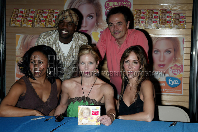 Christina Applegate with cast members from the Broadway Musical Revival of SWEET CHARITY launch the release for the Original Cast Recording with an Autograph signing at FYE Rockefeller Center in New York City..( Top L to R ) Rhett George, Paul Schoeffling, Kyra Da Costa, Christina applegate and Janine LaManna.July 14, 2005.© Walter McBride /
