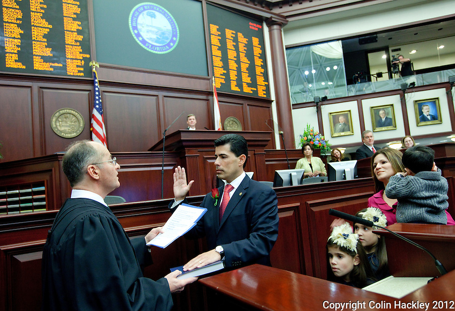 TALLAHASSEE, FLA. 1/10/12-OPENING011012 CH-Rep. Jose Oliva, R-Miami Lakes, takes the oath of office from Florida Supreme Court Chief Justice Charles Canady  during the opening day of the 2012 legislative session, Tuesday at the Capitol in Tallahassee. .COLIN HACKLEY PHOTO