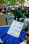 "Sign reads ""Last Week JP Morgan Chase donate $4.6 million to NYPD"" at the Occupy Wall Street Protest in New York City October 6, 2011."