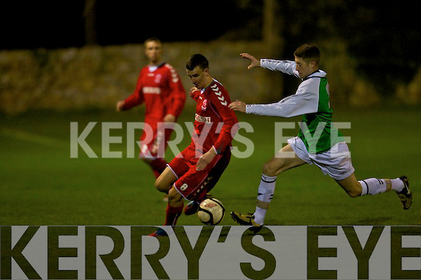 Kerry's Scott Monaghan tackles Munster senior league's Colin Lyons in the Oscar Traynor cup at Mounthawk park, Tralee on Friday.