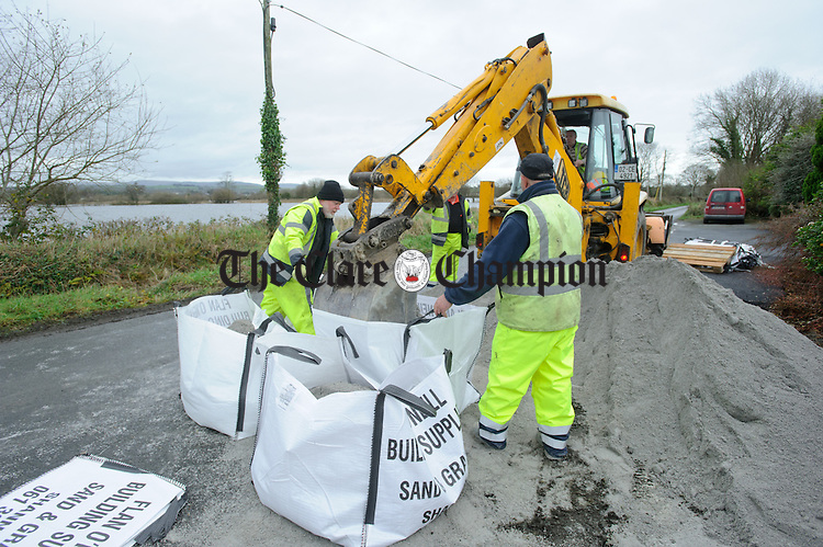 Clare County Council workers fill sand bags as Springfield, Clonlara residents prepare for flooding due to water being released at the Parteen Weir. Photograph by John Kelly.