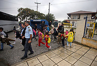 Pictured: Children of refugees are escorted inside the Profitis Volvis primary school, Salonica, Greece. Monday 10 October 2016<br /> Re: Locals protesting against children of refugees attending school, have locked the gates of the primary school in Profitis Volvis on the outskirts of Thessaloniki in northern Greece. Police were present and the children were escorted through another gate.