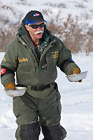 Musher Jeff King feeds his dogs in Candle, the half way point of the 2008 All Alaska Sweepstakes sled dog race.
