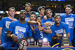 The Kentucky Wildcats pose for a photo after the game against the Texas A&M Aggies at the SEC Tournament Championship at Bridgestone Arena in Nashville, TN, on Sunday, March 13, 2016. Kentucky defeated Texas A&M 81-77. Photo by Michael Reaves | Staff.