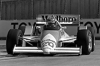 LONG BEACH, CA - APRIL 13: Emerson Fittipaldi drives his March 86C/Cosworth during the Toyota Grand Prix of Long Beach CART Indy Car race on the temporary Long Beach Street Circuit in Long Beach, California, on April 13, 1986.