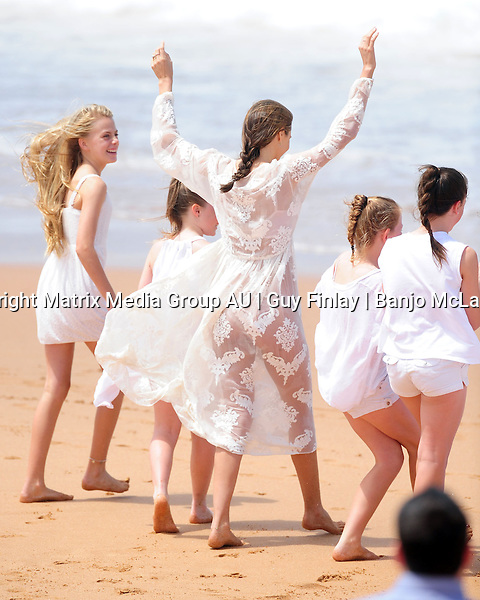 10 FEBRUARY 2013 SYDNEY AUSTRALIA<br /> <br /> EXCLUSIVE PICTURES<br /> <br /> Australian born international supermodel Miranda Kerr pictured on location at Palm Beach for a Kora Organics photoshoot. Miranda and her young friends played ring-a-ring-a-rosy before Miranda demonstrated her gymnastic skills by popping some wardrobe malfunctioning cartwheels in some lace panties and a lace dress.