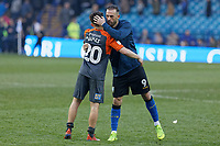 (L-R) Daniel James of Swansea City is hugged by Steven Fletcher of Sheffield Wednesday during the Sky Bet Championship match between Sheffield Wednesday and Swansea City at Hillsborough Stadium, Sheffield, England, UK. Saturday 23 February 2019
