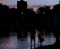 Children playing in the pond of La Fontaine Park in Montreal