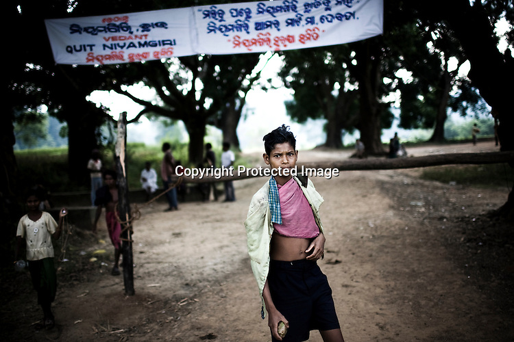A young protester is seen with a stone at the makeshift gate that has been set up by the local kondh villagers to stop Vedanta officials to go across to the proposed area for mining in the Niyamgiri hill is seen in Lanjigarh, Orissa.