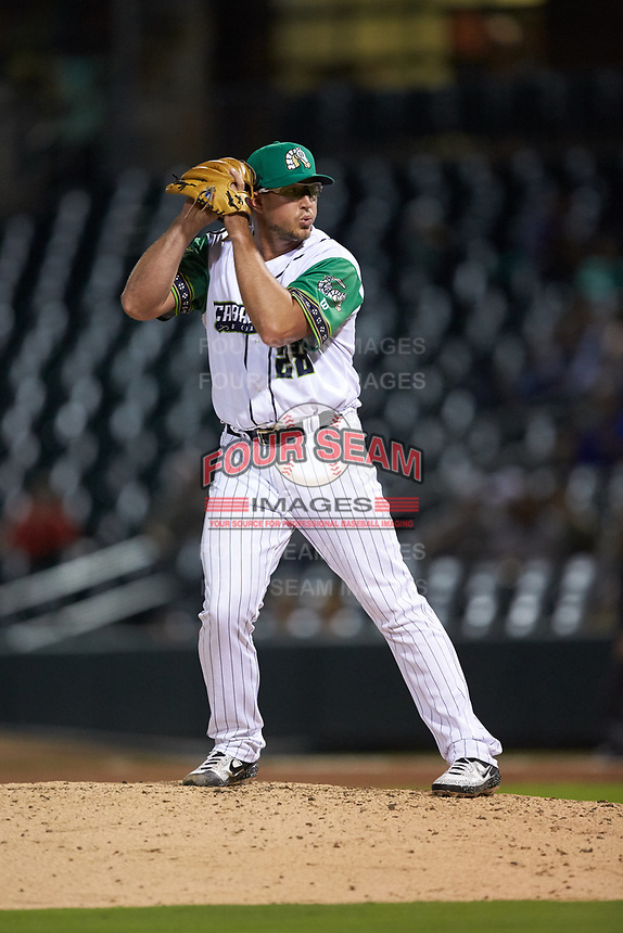 Caballeros de Charlotte relief pitcher Carson Fulmer (28) comes set against the Buffalo Bisons at BB&T BallPark on July 23, 2019 in Charlotte, North Carolina. The Bisons defeated the Caballeros 8-1. (Brian Westerholt/Four Seam Images)