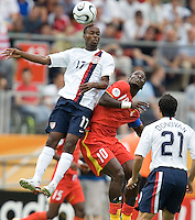 USA's DaMarcus Beasley (17) heads the ball over Ghana's Stepen Appiah (10). Ghana defeated the USA 2-1 in their FIFA World Cup Group E match at Franken-Stadion, Nuremberg, Germany, June 22, 2006. Ghana advances to round of 16 and the USA is out of the tournament.