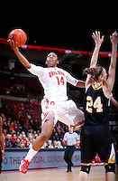 Ohio State Buckeyes guard Ameryst Alston (14) tosses in a one-handed layup as she leaps past Appalachian State Mountaineers forward Maryah Sydnor (24) during the second half of the NCAA women's basketball game between the Ohio State Buckeyes and the Appalachian State Mountaineers at Value City Arena in Columbus, Ohio, on Friday, Dec. 20, 2013. The Buckeyes overcame a 21-18 deficit at the half to defeat the Mountaineers 52-38.  (Columbus Dispatch/Sam Greene)