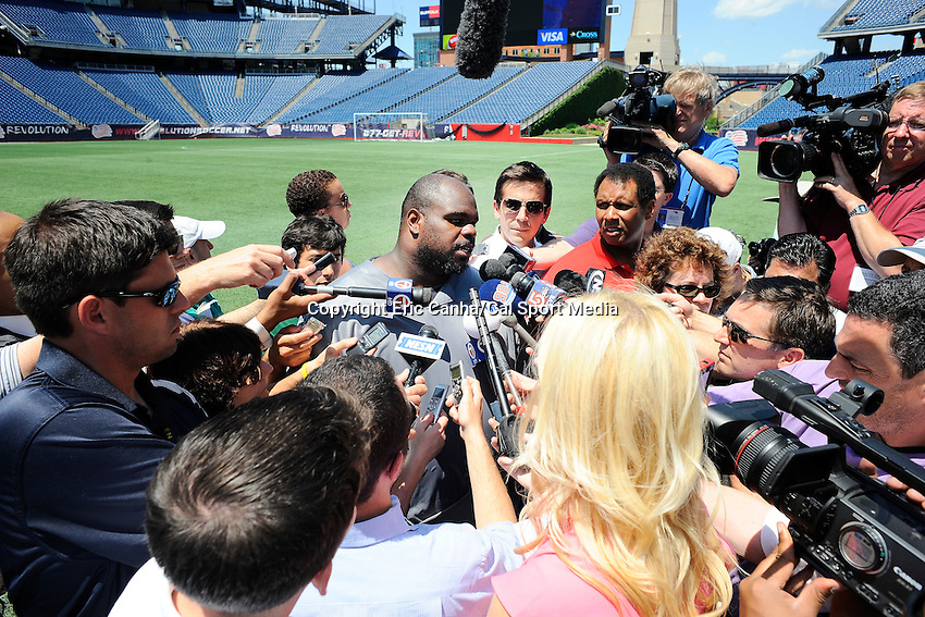 MAY 31 2012 New England Patriots nose tackle Vince Wilfork #75 answering questions on the field at Gillette Stadium, after the team's OTA's  in  Foxborough, Massachusetts. Eric Canha/CSM
